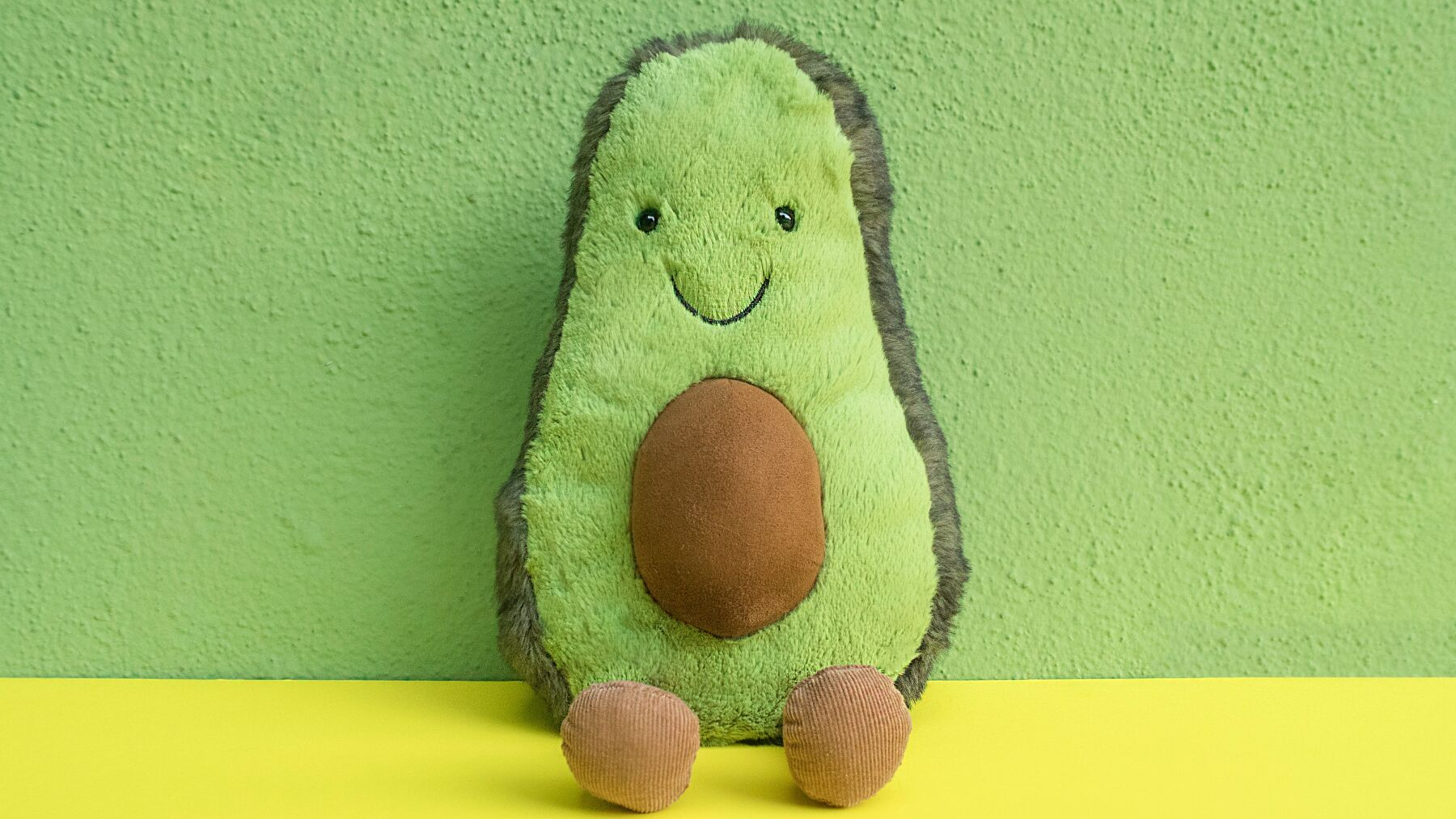Smiling avocado plush toy