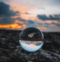 Image of the Earth reflected in a marble by Louis Maniquet via Unsplash