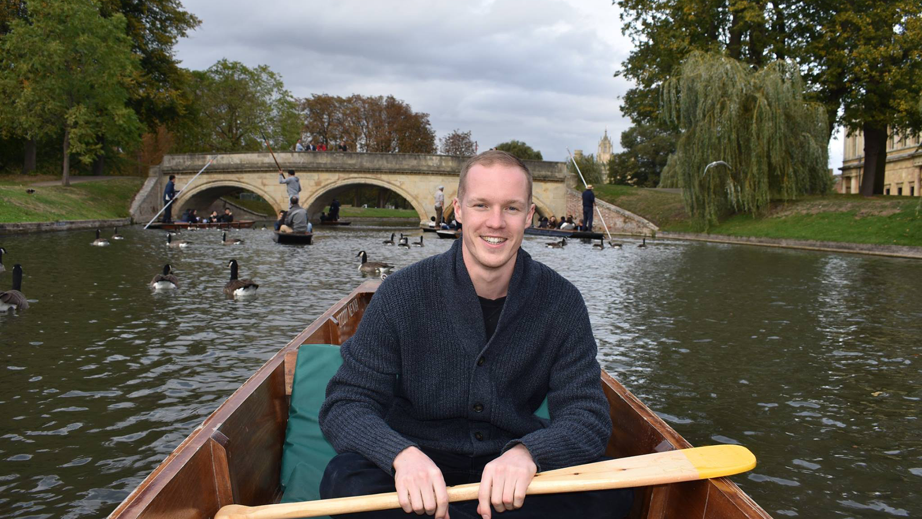Adam, Wellcome technician, in a boat on the weekend