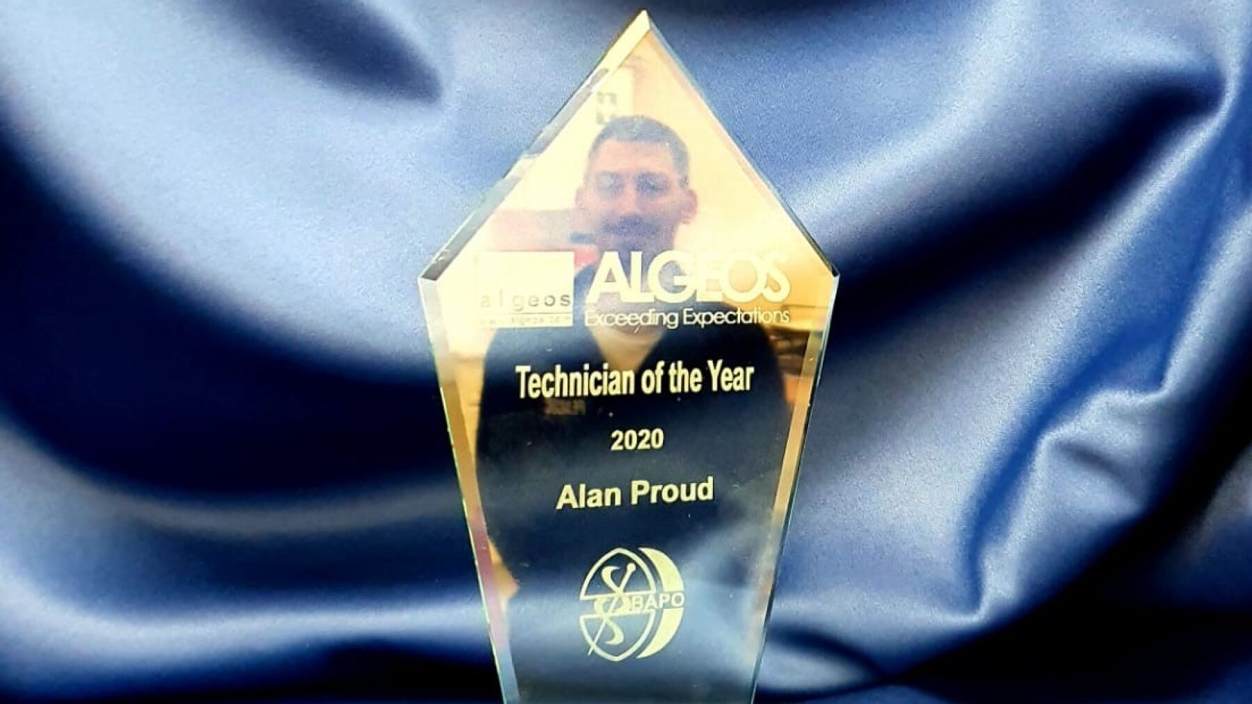 Alan's reflection in his award