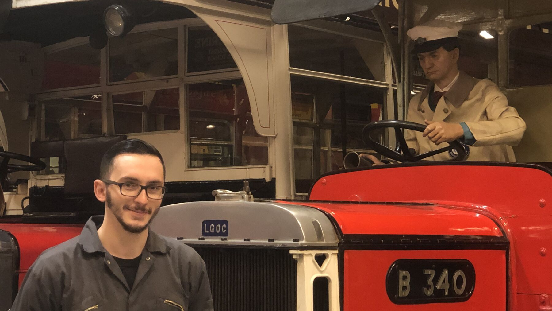 Alex - a curatorial technician at the London Transport Museum with a waxwork dummy in an old-fashioned London bus
