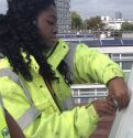 Trainee technician maintaining a solar panel