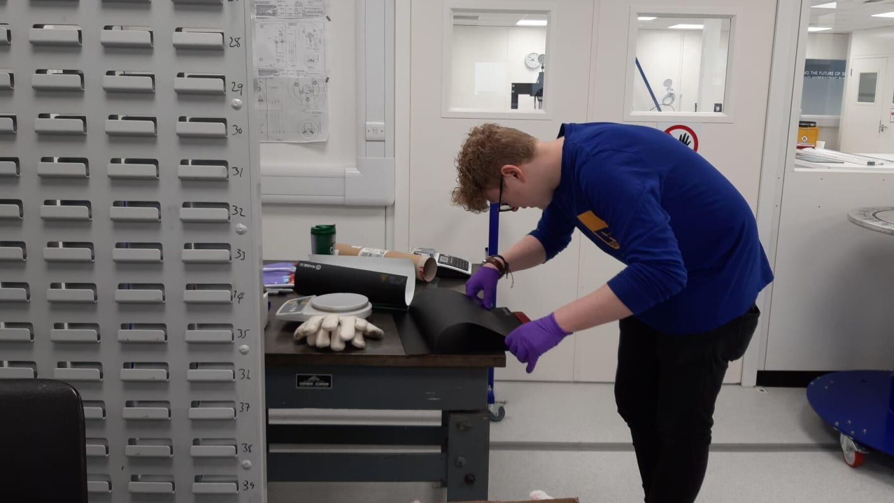 George at work; he has used his specialist knowledge of 3D printing to create PPE for frontline staff
