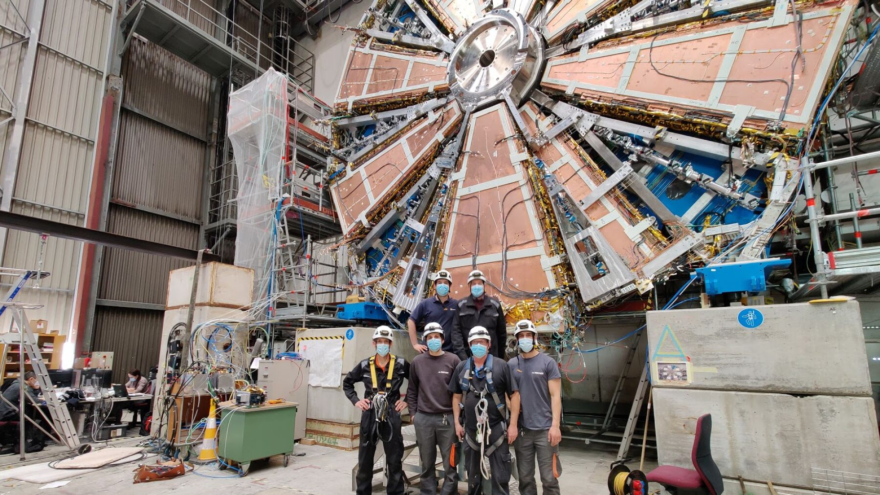 Jamie and his team in front of the New Small Wheel at CERN - it is 10m in diameter