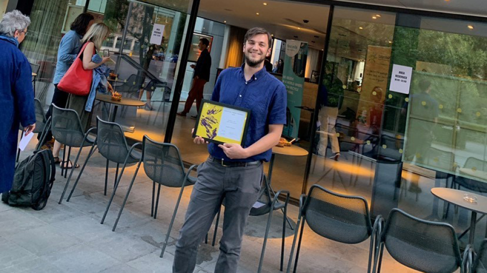 Jamie with an award won for his sustainability work