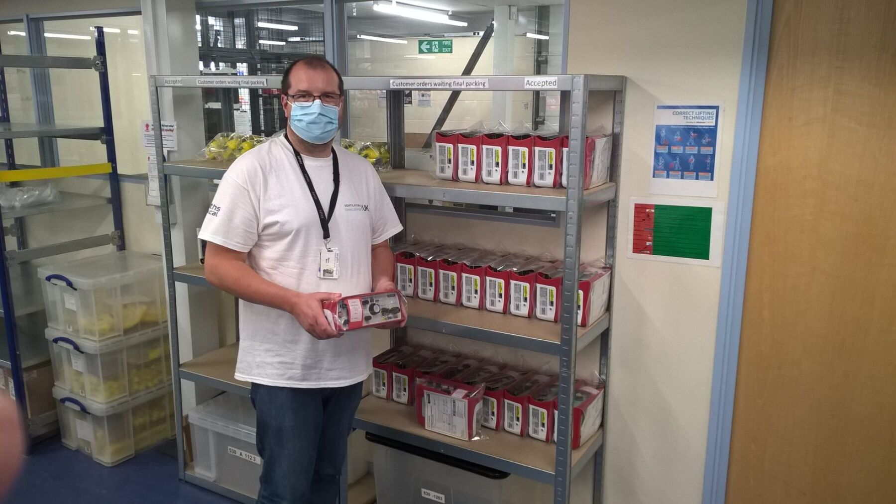 Steven, technician at Smiths, standing with one of the ventilators he helped to create