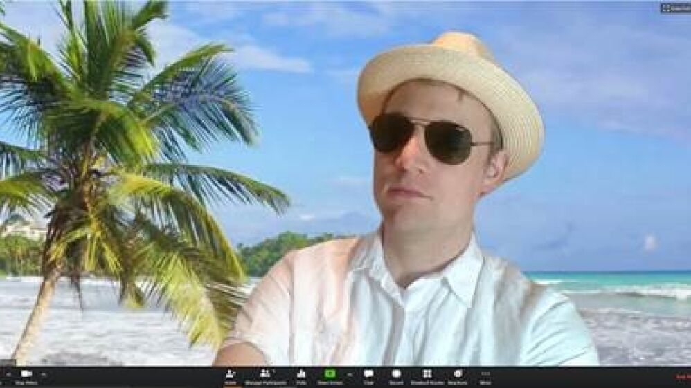 Tom holding a meeting from a virtual Bahamas