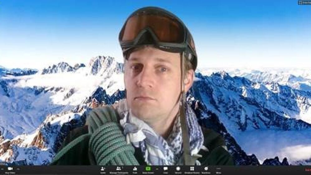 Tom holding a virtual meeting all the way 'from the Alps!""